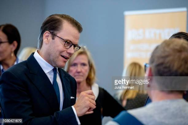 Prince Daniel of Sweden listens to a student health professional as he attends Eventhalsan's Launch Day at Svenska Massan on September 10 2018 in...