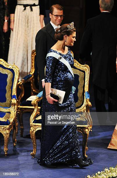 Prince Daniel of Sweden smiles as his pregnant wife Crown Princess Victoria of Sweden at the Nobel Prize Award Ceremony 2011 at Stockholm Concert...