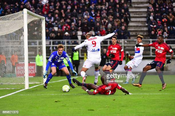 Prince Desir Gouano of Amiens makes a last ditch tackle on Mariano Diaz of Lyon during the Ligue 1 match between Amiens SC and Olympique Lyonnais at...