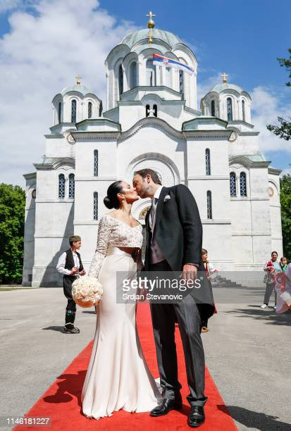Prince Dushan and Valerie De Muzio kisses after their wedding ceremony at Oplenac church on May 25 2019 in Topola Serbia Prince Dushan Karadjordjevic...