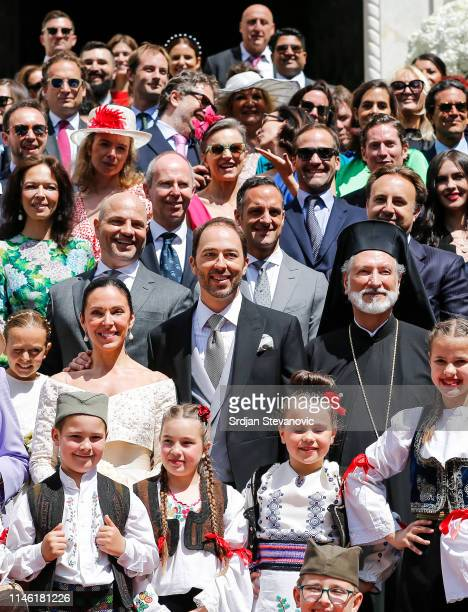 Prince Dushan and Valerie De Muzio pose for a group photo after their wedding ceremony at Oplenac church on May 25 2019 in Topola Serbia Prince...