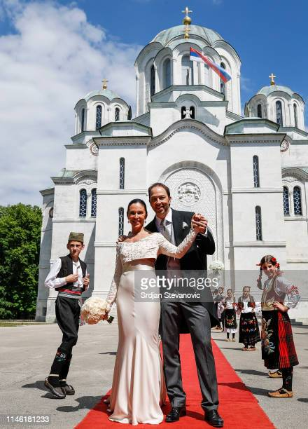 Prince Dushan and Valerie De Muzio pose for a photo after their wedding ceremony at Oplenac church on May 25 2019 in Topola Serbia Prince Dushan...