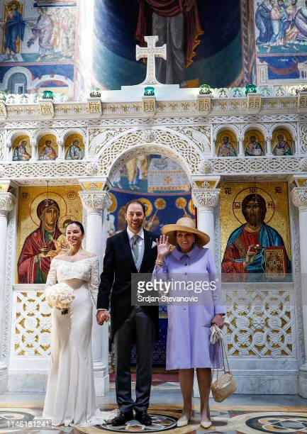 Prince Dushan and Valerie De Muzio pose for a photo with Princess Barbara mother of Prince Dushan after their wedding ceremony at Oplenac church on...