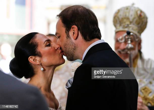 Prince Dushan kisses his bride Valerie De Muzio during their wedding ceremony at Oplenac church on May 25 2019 in Topola Serbia Prince Dushan...
