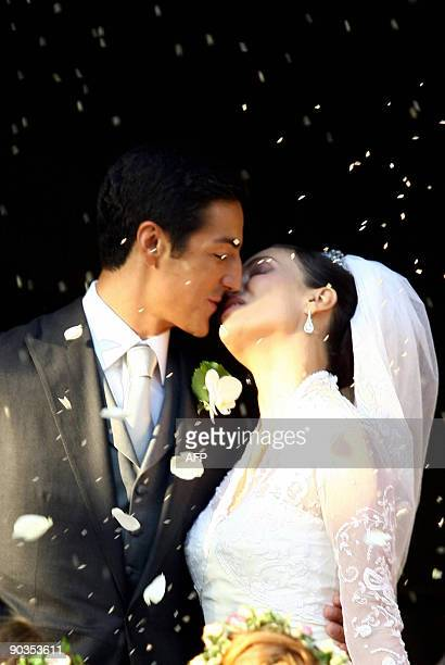 Prince Edouard de Ligne kisses his bride Italian actress Isabella Orsini at their wedding in Antoingt on September 5 2009 AFP PHOTO/BELGA/JULIEN...