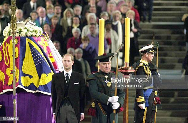 Prince Edward and Prince Charles stand in front of the flag drapped coffin of Queen Elizabeth the Queen Mother as she LiesinState and is guarded at...
