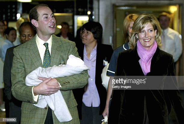 Prince Edward and wife Sophie pose with their new baby outside Frimley Park Hospital on November 23 2003 in Frimley England The earl and countess...