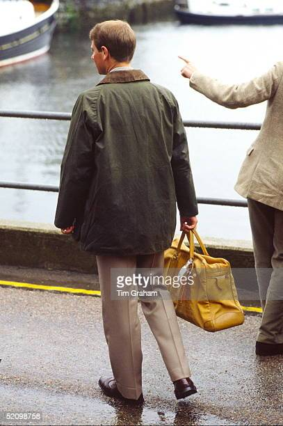 Prince Edward Arriving In Scrabster For The Annual Summer Holiday In Scotland Carrying A Bag And Wearing A Barbourstyle Jacket