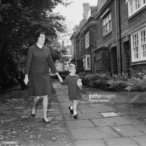 Prince Edward arriving with his nanny Mabel Anderson for his first day of school at Gibbs School in Kensington, London, UK, 7th October 1968.