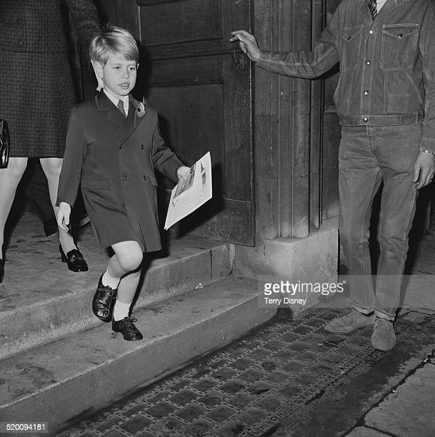 Prince Edward, closely followed by his governess, Lavinia Keppel, leaving the Children's Book Show in Westminster, London, 7th November 1969.