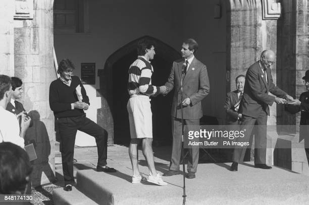Prince Edward congratulates running star Sebastian Coe in 1920s period sports gear for emulating the feat of Lord Burghley in racing round Great...