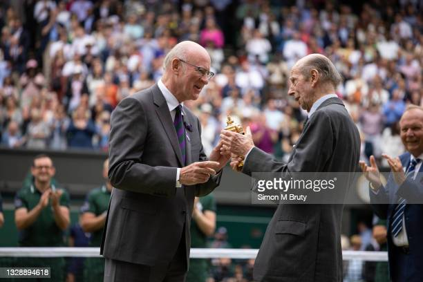 Prince Edward, Duke of Kent is presented with a replica Men's trophy by the chairman of AELTC Ian Hewitt after the Men's Singles Final at The...