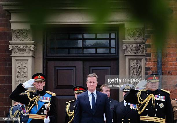 Prince Edward Duke of Kent Prime Minister David Cameron and General Sir Chris Deverell are joined by other dignataries as they take the salute during...