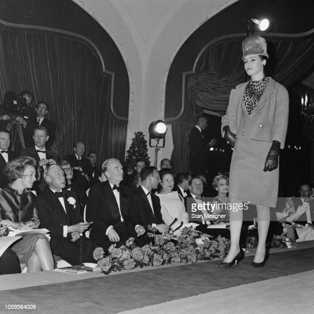 Prince Edward, Duke of Windsor pictured 2nd from left with Wallis Simpson, Duchess of Windsor seated in the front row at a fashion show featuring...