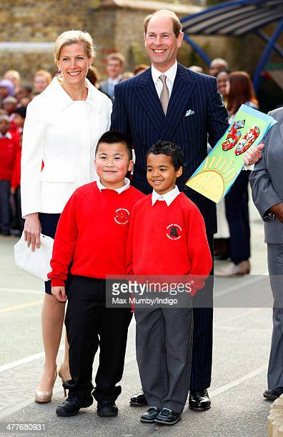 Prince Edward Earl of Wessex accompanied by Sophie Countess of Wessex receives a 50th birthday card from pupils during a visit to the Robert Browning...
