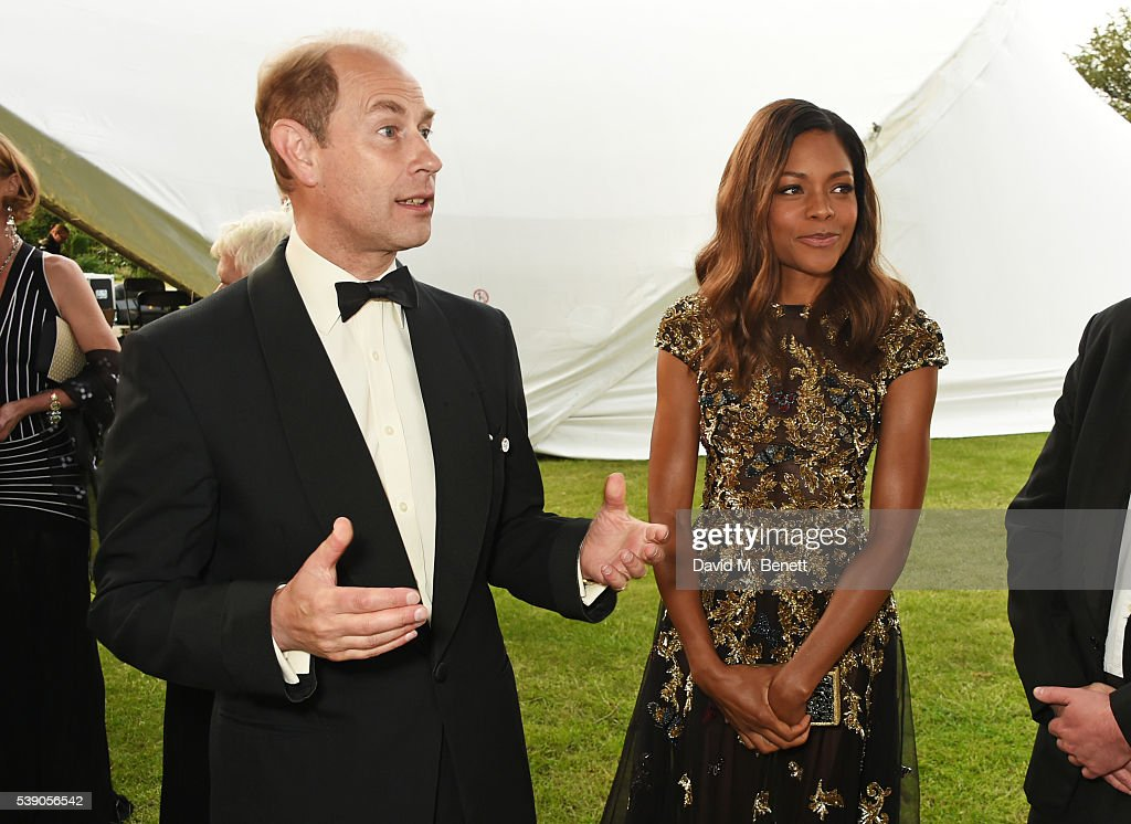 Prince Edward, Earl of Wessex, and Naomie Harris attend the Duke of Edinburgh Award 60th Anniversary Diamonds are Forever Gala at Stoke Park on June 9, 2016 in London, England.