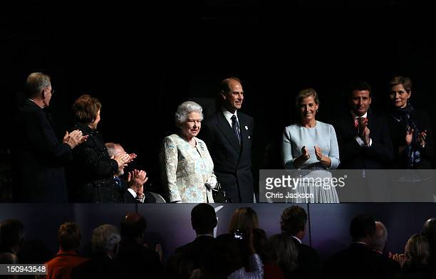 Prince Edward Earl of Wessex and Sophie Countess of Wessex LOCOG chairman Lord Sebastian Coe and his wife Carole Annett applaud Queen Elizabeth II...