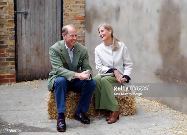 Prince Edward, Earl of Wessex and Sophie, Countess of Wessex sit on a hay bale during a visit to Vauxhall City Farm on October 1, 2020 in London,...