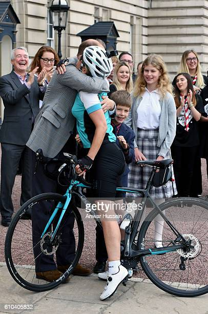 Prince Edward Earl of Wessex greets Sophie Countess of Wessex as she arrives at Buckingham Palace after completing her bike ride from Edinburgh to...