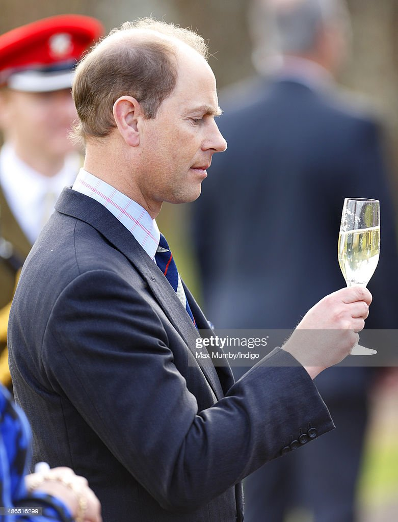 Prince Edward, Earl of Wessex holds a glass of English sparkling wine as he and Sophie, Countess of Wessex visit the Three Choirs Vineyards on April 24, 2014 in Newent, England.