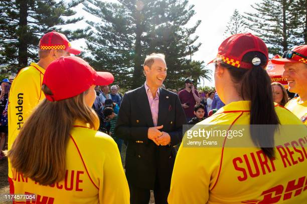 Prince Edward, Earl of Wessex is greeted by members of Surf Life Saving Illawarra as he arrives at North Wollongong Beach on September 14, 2019 in...