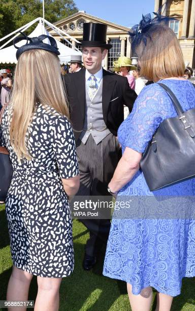 Prince Edward Earl of Wessex meets guests during a garden party at Buckingham Palace on May 15 2018 in London England