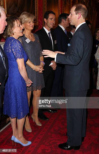 Prince Edward Earl of Wessex meets television presenters Alice Beer and Esther Rantzen during a reception to celebrate the patronages affiliations of...