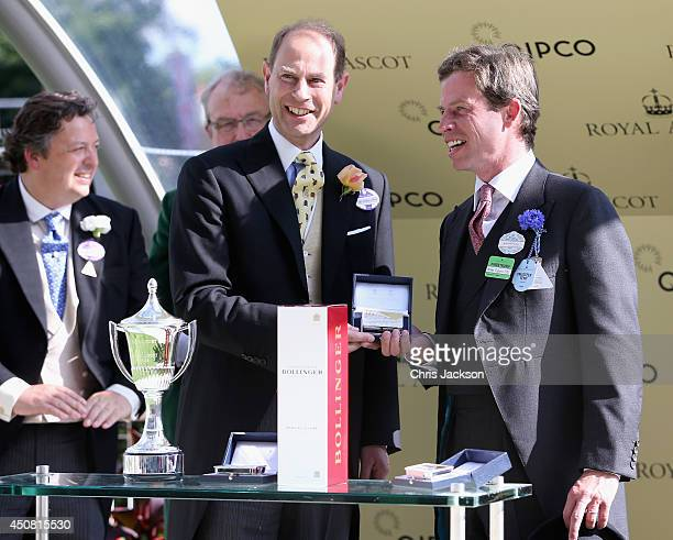 Prince Edward Earl of Wessex presents owner and trainer Jamie Osbourne with the Royal Hunt Cup after his horse Field of Dream won the race during day...
