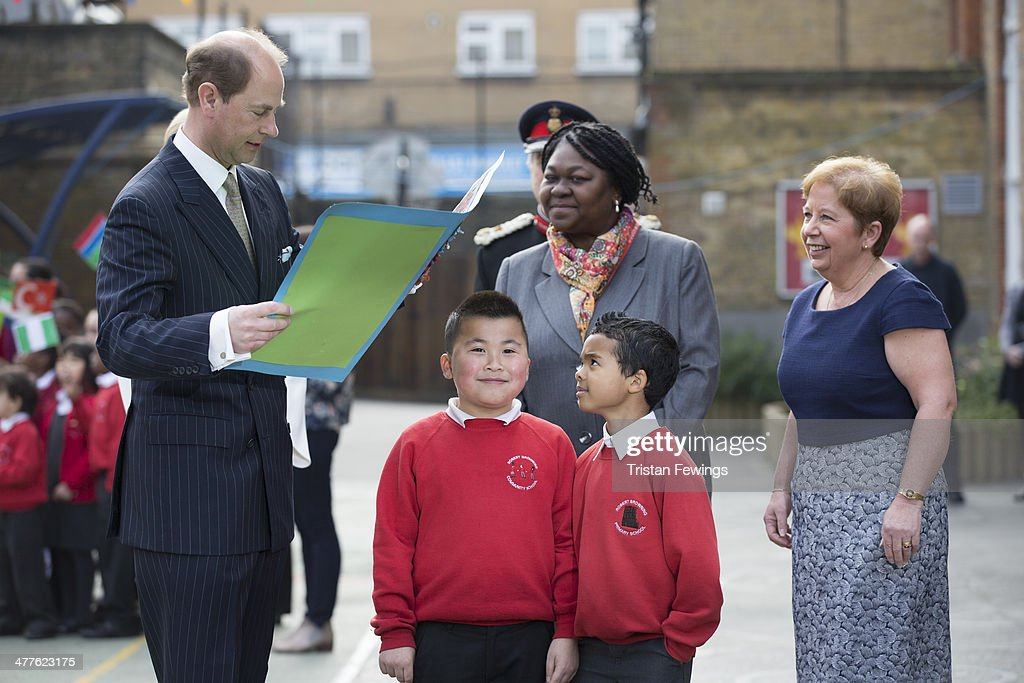 Prince Edward, Earl of Wessex receives a birthday card from John Lieu and Pharez Billy next to Sophie, Countess of Wessex during an official visit on the Earl's 50th Birthday at Robert Browning Primary School on March 10, 2014 in London, England.