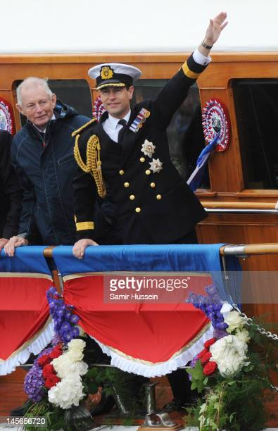 Prince Edward Earl of Wessex salutes from The royal barge 'The Spirt of Chartwell' as it takes part in The Thames River Pageant part of the Diamond...