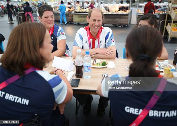 Prince Edward Earl of Wessex sits with Paralympians Andrea Green Martine Wright and Jessica Frezza of Great Britain in the dining hall of the Olympic...