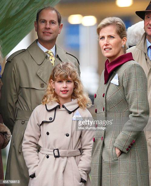 Prince Edward, Earl of Wessex, Sophie Countess of Wessex and their daughter Lady Louise Windsor watch the racing from the Parade Ring as they attend...