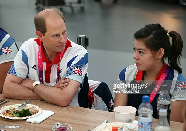 Prince Edward Earl of Wessex talks to sitting volleyball player Julie Rogers of Great Britain in the dining hall at the Olympic Village on day 1 of...