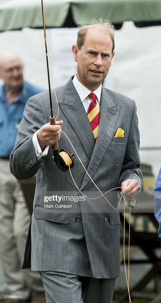Prince Edward, Earl of Wessex tries his hand at fly fishing during a to visit the New Forest and Hampshire county show at The Showground, New Park on July 31, 2013 in Brockenhurst, England.