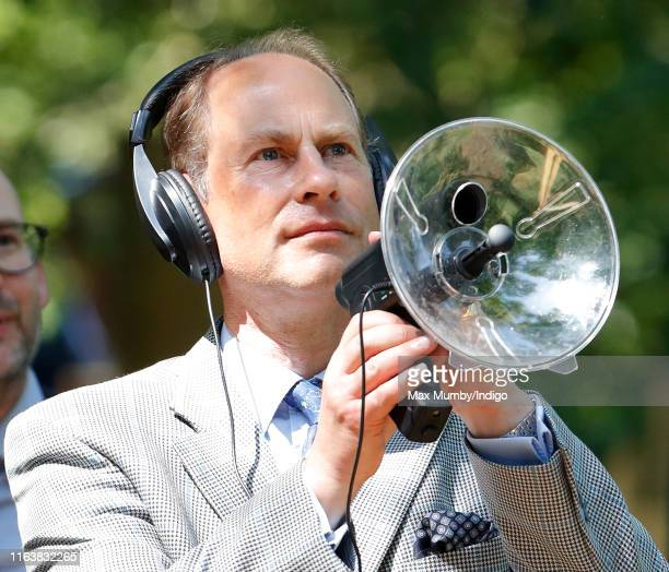 Prince Edward Earl of Wessex uses a parabolic microphone to listen to Eurasian brown bears as he visits The Wild Place Project at Bristol Zoo on July...