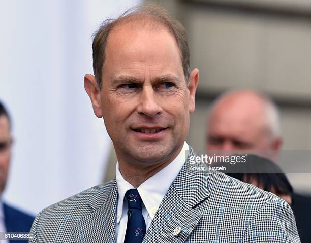 Prince Edward Earl of Wessex waits for Sophie Countess of Wessex to arrive in the forecourt of Buckingham Palace to finish her bike ride from...