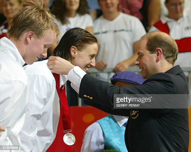 Prince Edward gives the silver medal to England's Karen Pickering after the 2002 Manchester Commonwealth Games women's 4x100m freestyle finals 03...