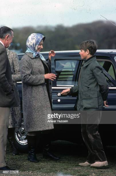 Prince Edward opens the car door for his mother Queen Elizabeth ll as they attend Badminton Horse Trials on April 16 1977 in Badminton England