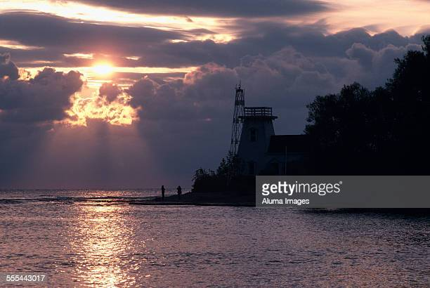 prince edward point lighthouse at sunrise - contea di prince edward ontario foto e immagini stock
