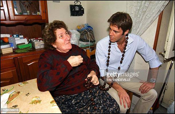 Prince Emanuele Filiberto with an old lady who is about to protect him from bad spells in Italy on April 29th 2003