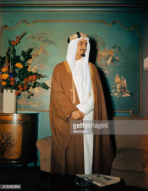 Prince Emir Faisal second son of King Ibn Saud of Saudi Arabia is shown standing in front of a painting