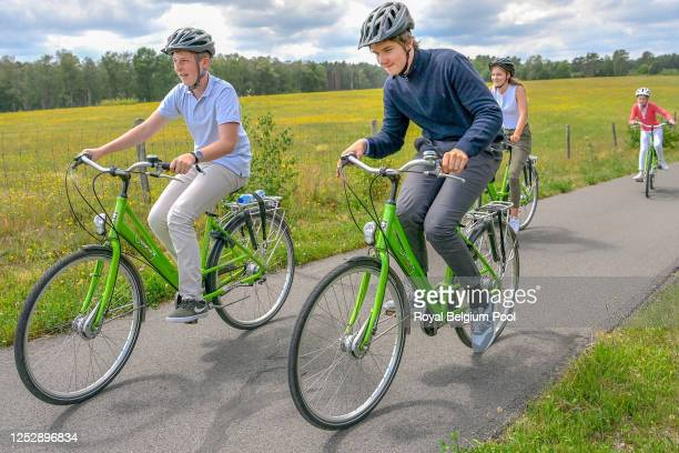 Prince Emmanuel of Belgium and Prince Gabriel of Belgium ride bikes on a visit to the Bokrijk Parc and Open Air Museum, on June 27, 2020 in Genk,...
