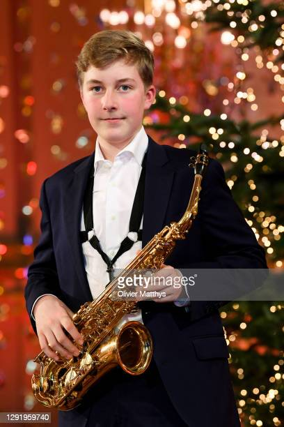 Prince Emmanuel of Belgium plays the saxophone during the Christmas concert with the Scala Choirat the Royal Palace on December 17, 2020 in Brussels,...