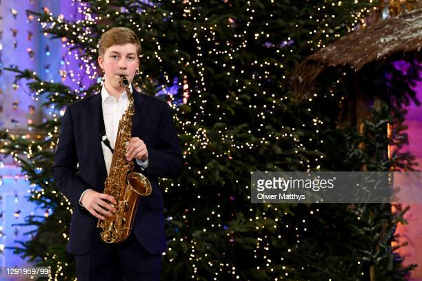 Prince Emmanuel of Belgium plays the saxophone during the Christmas concert with the Scala Choir at the Royal Palace on December 17, 2020 in...