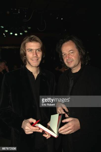 Prince Emmanuel signs a copy of his book for Gonzague Saint Bris at the evening at the Bains