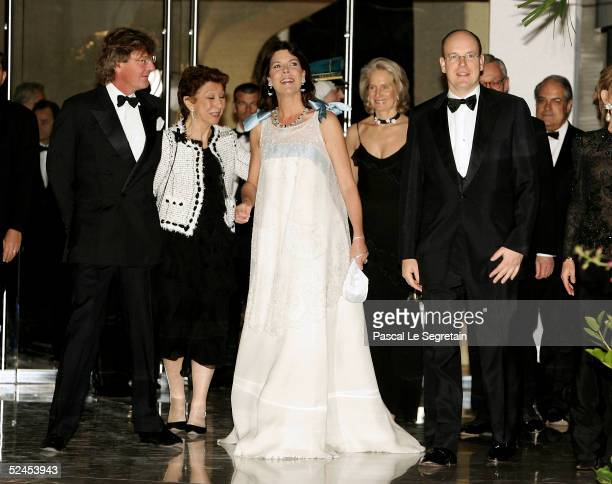Prince Ernst August of Hanover Princess Caroline of Hanover and Prince Albert Of Monaco arrive at the Rose Ball 2005 at The Sporting Monte Carlo on...