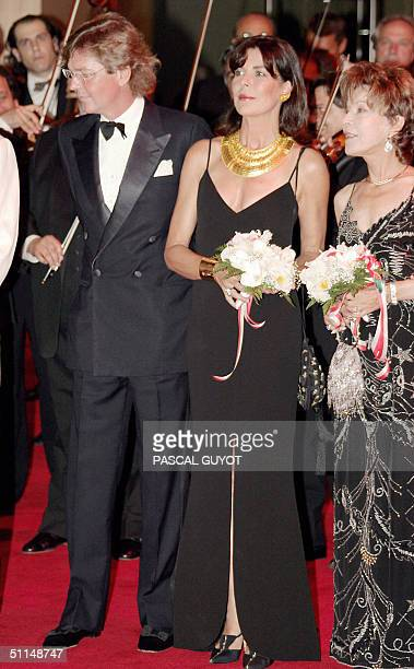 Prince Ernst August of Hanovre and his wife Princess Caroline of Hanovre arrive 06 August 2004 at MonteCarlo Sporting Club to attend the annual Red...