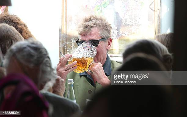 Prince Ernst August von Hannover and Simona attend the Oktoberfest Opening in Kaeferzelt at Theresienwiese on September 20, 2014 in Munich, Germany.