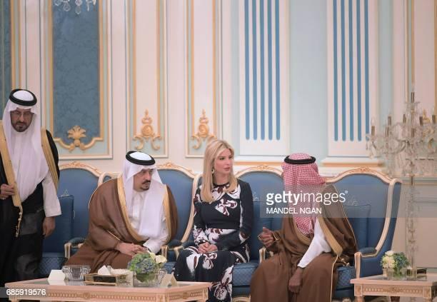 Prince Faisal bin Bandar the governor of the Saudi capital Riyadh listens on as Ivanka Trump talks to an unidentified Saudi official during a...