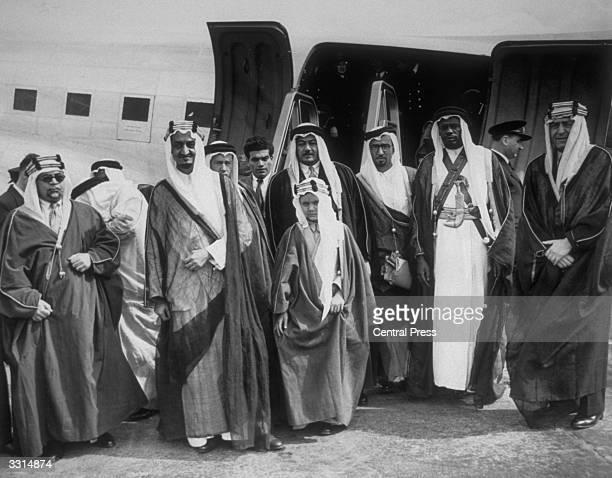 Prince Faisal , later King Faisal, second from left, who led the Saudi Arabian delegation at the London conference on Palestine, at London Airport.